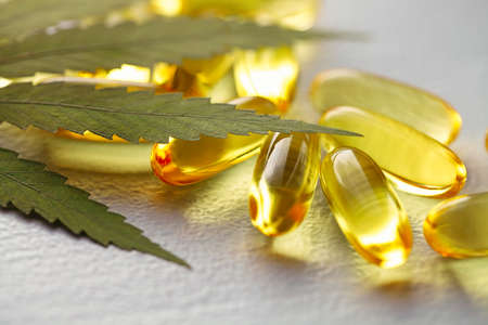 Cannabis Hemp Oil or CBD Oil Capsules, Food Organic Food Supplements. Alternative medicine concept. Cosmetics and skin care products