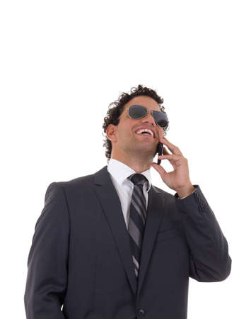 man talking on the phone and laughing Imagens
