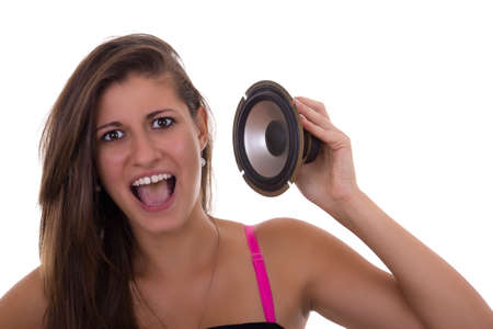 cute teen girl: cute teen girl holding speaker with open mouth