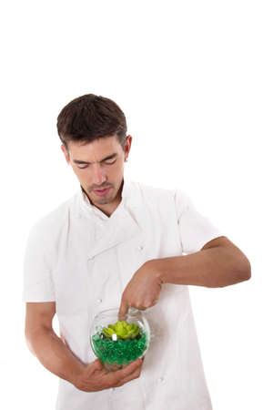 stiring: Cook preparing meal and stiring something in the bowl
