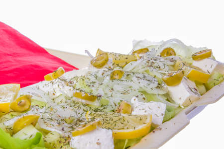 salad portion with white cheese olives onion lemon and dill photo