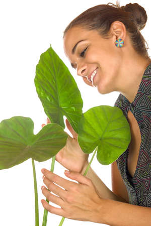 women maintain plant gently with her hands