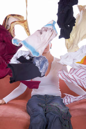 disarrangement: clothes tossed and scattered everywhere and up in the air
