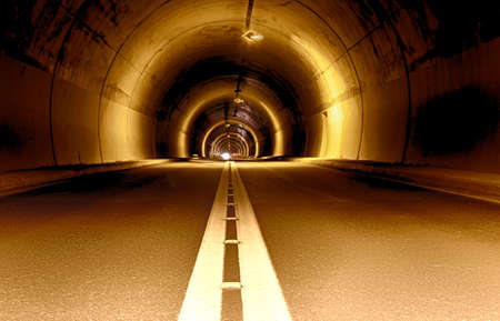 long tunnel at night and coming car from far