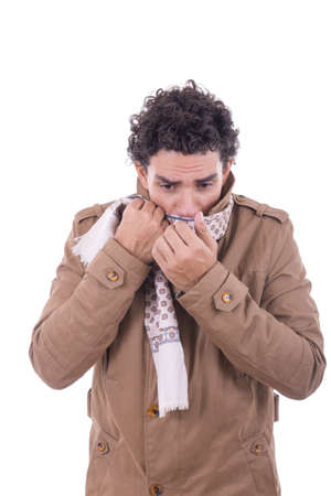 adult man in the coat covers the face with scarf against the coldness photo