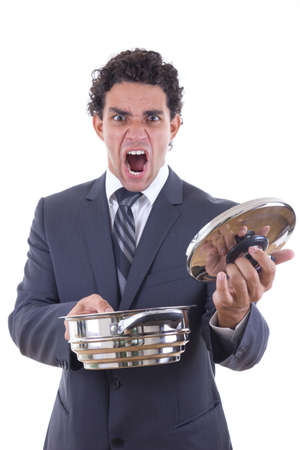 adult dissatisfied man in business suit holding pot for cooking with expression photo