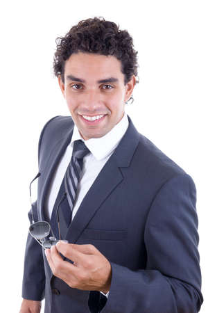 friendly businessman in suit holding sunglasess and smiling photo