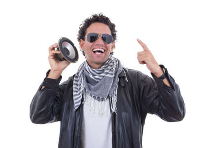 man in a leather jacket with speaker smiling photo