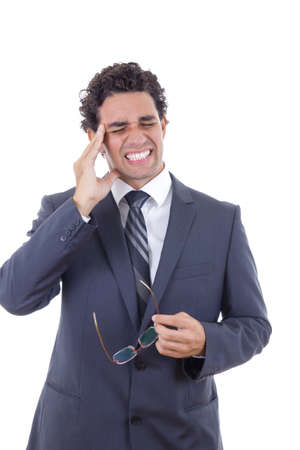 man in business suit with a headache holding glasses photo