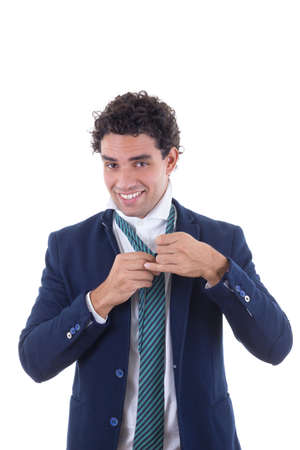 adult man in business suit tied tie with smile photo
