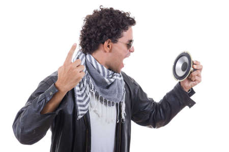 man in a leather jacket yelling to speaker photo
