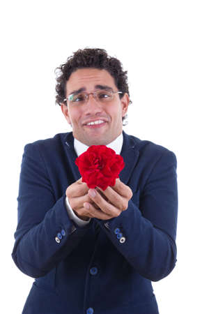 nerd in business suit with expression holding flower photo