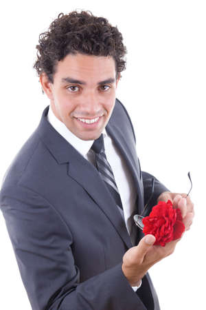 the seducer: seducer in suit and sunglasess smiling  with rose