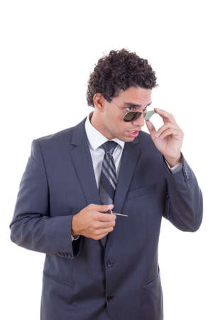 surprised young businessman with glasses holding keys photo