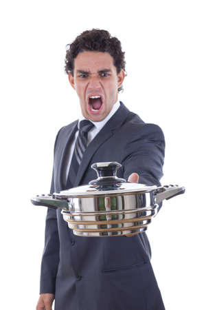 adult man yelling and looking at pot for cooking with expression photo