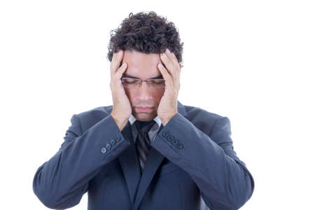 preoccupied: businessman with glasses holding his head in pain