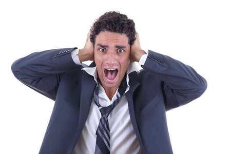 man in business suit holding his head and screaming