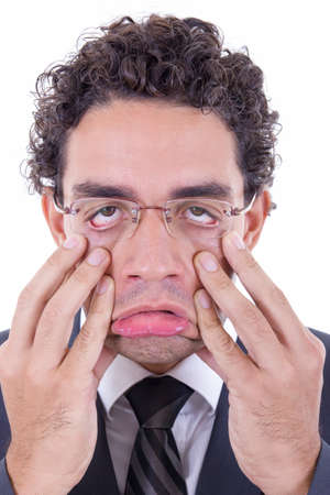 resilient: young man with glasses stretching his face