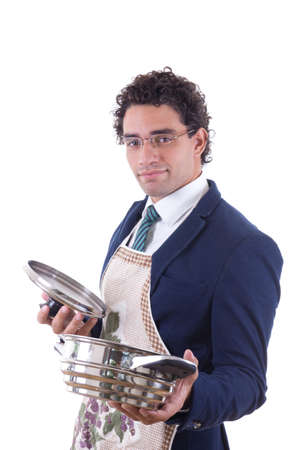 man in suit with an apron holding a cooking pot photo