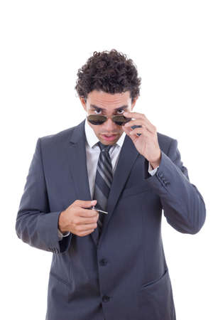 man with glasses holding keys and looking forward photo
