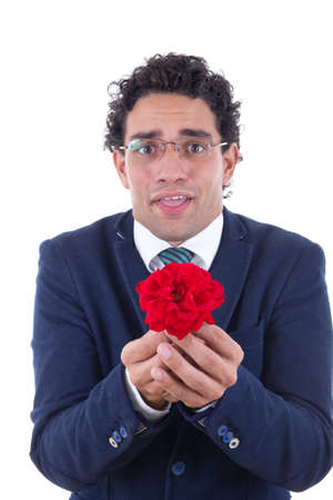 nerd in suit with expression holding flower photo