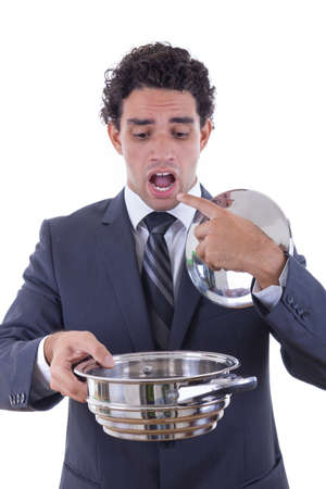 sad man with expression in suit holding cooking pot and asking for lunch photo