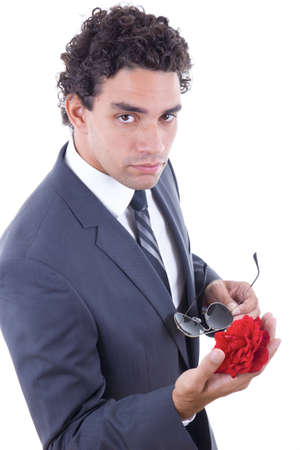 the seducer: seducer in suit with sunglasess holding rose
