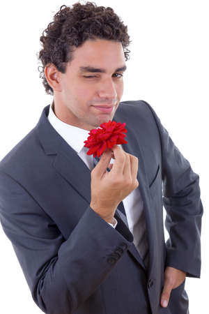 the seducer: handsome seducer in suit with rose Stock Photo