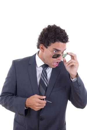 surprised and shocked young businessman with glasses holding keys photo