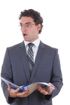 commotion: surprised young businessman holding an open notebook Stock Photo