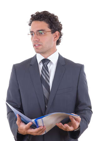 Young male businessman holding an open notebook photo
