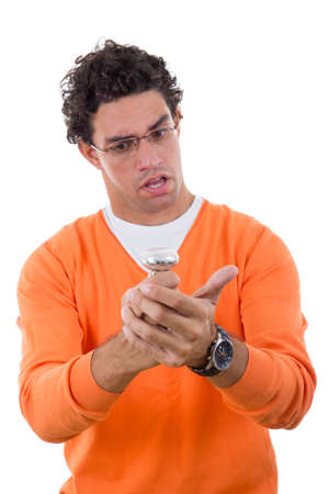 confused man with glasses holding light bulb in his hands photo