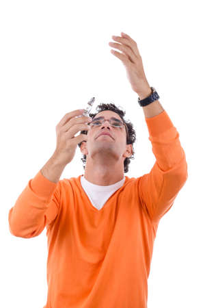 man electrician in orange sweater with glasses placing light bulb photo