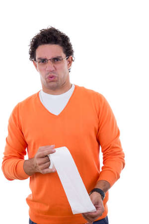 man in orange sweater holding toilet paper with stomachache photo