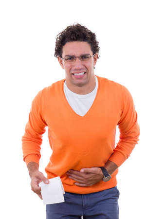 stressed man in need with stomach problems holding toilet paper in orange sweater photo