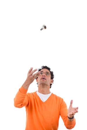 man with glasses throwing light bulb in the air photo