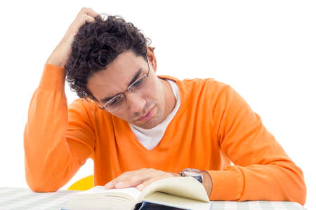 adult handsome man with glasses in orange sweater reading book photo