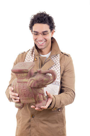 artifact: smiling professor in coat with glasses looking old artifact