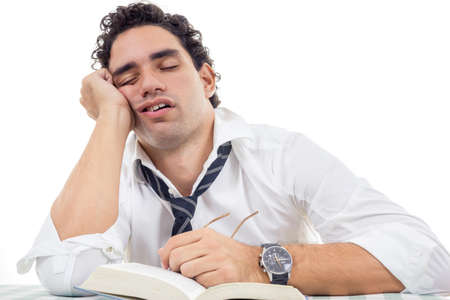 sleepy and tired man with glasses in white shirt and tie sitting with book photo
