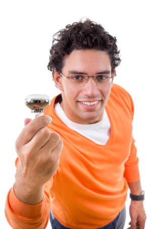 smart man in orange sweater with glasses holding light bulb with an idea photo