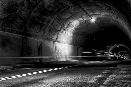 deepness: scary tunnel at night with rays of light Stock Photo