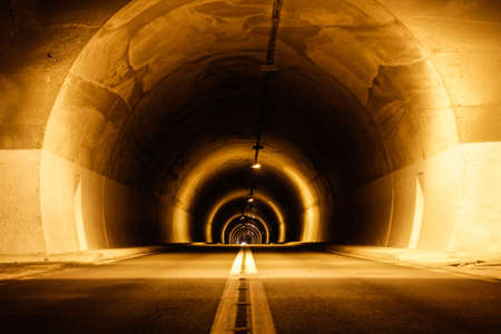 long mystical underground tunnel with lights