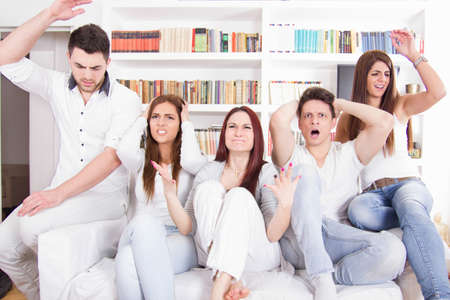 upset friends watching football game and their favorite team is losing photo