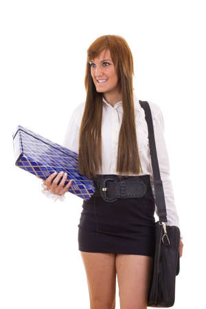 smiling business woman traveling in black skirt holding briefcase and folder photo