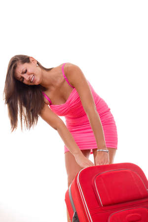 beautiful girl in a dress with heavy suitcase for travel photo