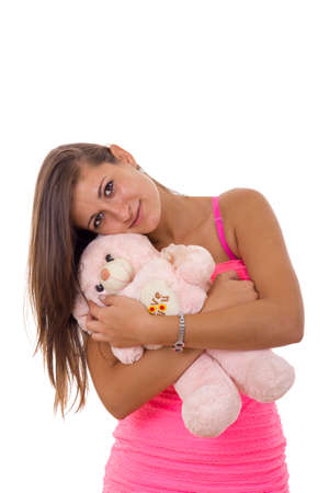 sweet beautiful young woman holding teddy bear and hugging him photo