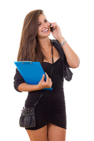 carying: business woman carying folder and purse talking on the phone smiling