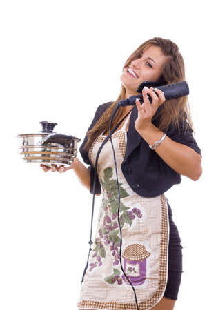 overworking: experienced smiling business woman cooking and talking on the phone