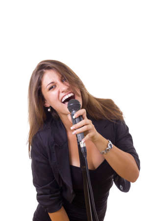 gorgeous young woman in black dress holding microphone and singing photo