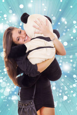 smiling thrilled business woman hugging teddy bear in her arms photo